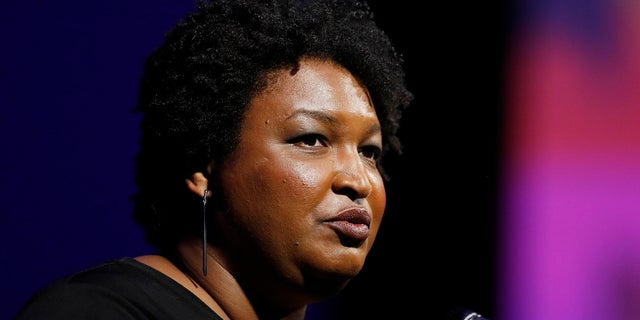 This July 22, 2019, file photo shows former Georgia House Minority Leader Stacey Abrams addressing the 110th NAACP National Convention, in Detroit.  (AP Photo/Carlos Osorio)