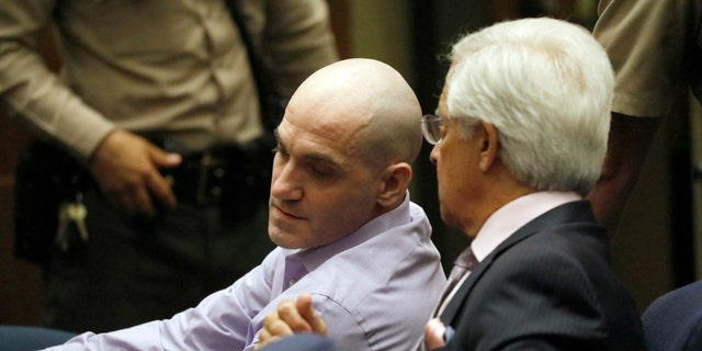 Michael Gargiulo, left, and his attorney, Daniel Nardoni, confer as guilty verdicts are read in Los Angeles Superior Court on Thursday. (Al Seib/Los Angeles Times via AP, Pool)