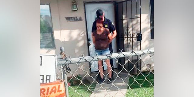 This April 22 photo by a Riverside County Animal Services officer shows the arrest of Deborah Sue Culwell at her Coachella, Calif., home. (Riverside County Animal Services via AP, File)