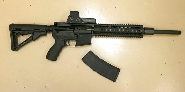 A custom-made semi-automatic hunting rifle with a detachable magazine, displayed at TDS Guns in Rocklin, Calif.