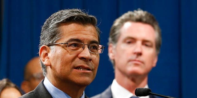 California Attorney General Xavier Becerra, left, accompanied by Gov. Gavin Newsom. Becerra is the leader of a group of blue states' defense of the ACA against a lawsuit led by a coalition of red states. (Associated Press)
