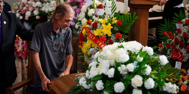 """When Basco arrived, people shouted blessings in English and Spanish. Before entering the funeral home, someone gave him a gift that appeared to be an El Paso t-shirt.<br data-cke-eol=""""1"""">"""