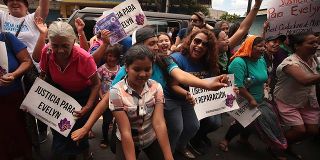 Women and girls celebrate outside court where Evelyn Hernandez was acquitted on charges of aggravated homicide in her retrial related to the loss of a pregnancy in 2016, in Ciudad Delgado on the outskirts of San Salvador, El Salvador, Monday, Aug. 19, 2019.