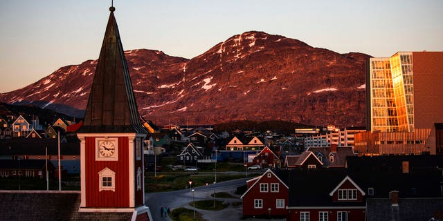 "In this Monday, July. 31, 2017 file photo the sun sets over Nuuk, Greenland. A spokeswoman for Denmark's royal palace says U.S. President Donald Trump's decision to postpone a visit to Denmark next month was ""a surprise."" Trump announced his decision by tweet after the Danish prime minister dismissed the notion of selling Greenland to the U.S. as ""an absurd discussion."""