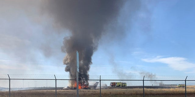 The aircraft slid off the end of the runway into the grass and caught fire. (California Highway Patrol via AP)