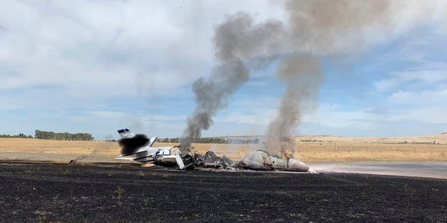 The scene where a jet burst into flames after aborting a takeoff Wednesday in Oroville, Calif. (California Highway Patrol via AP)