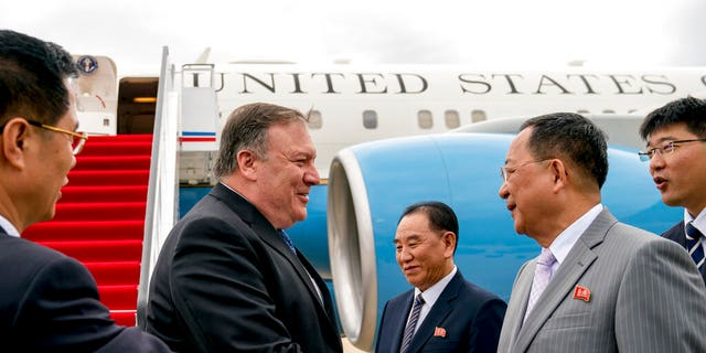 In this July 6, 2018, file photo, U.S. Secretary of State Mike Pompeo, second from left, is greeted by North Korean Director of the United Front Department Kim Yong Chol, center, and North Korean Foreign Minister Ri Yong Ho, second from right, as he arrives at Sunan International Airport in Pyongyang, North Korea.