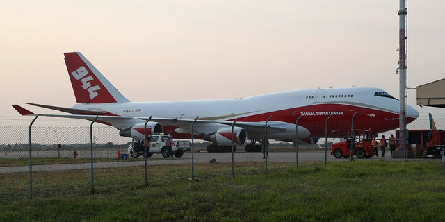 A Boeing 747-400 Global SuperTanker, stands on the tarmac before it starts firefighting operations, at the Viru Viru airport in Santa Cruz, Bolivia, Friday, Aug. 23, 2019. Bolivia, along with Brazil, is struggling to contain wildfires, many believed to have been set by farmers clearing land for cultivation. (AP Photo/Juan Karita)