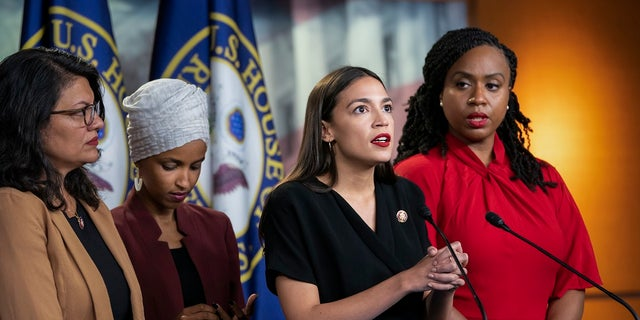 In this July 15, 2019, file photo, from left, Rep. Rashida Tlaib, D-Mich., Rep. Ilhan Omar, D-Minn., Rep. Alexandria Ocasio-Cortez, D-N.Y., and Rep. Ayanna Pressley, D-Mass., speak at the Capitol in Washington. A First Amendment group is asking Ocasio-Cortez to stop blocking Twitter users whom she doesn't agree with. (AP Photo/J. Scott Applewhite, File)
