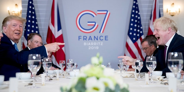 U.S. President Donald Trump, left, and Britain's Prime Minister Boris Johnson attend a working breakfast at the Hotel du Palais on the sidelines of the G-7 summit in Biarritz, France, Sunday, Aug. 25, 2019. (Associated Press)
