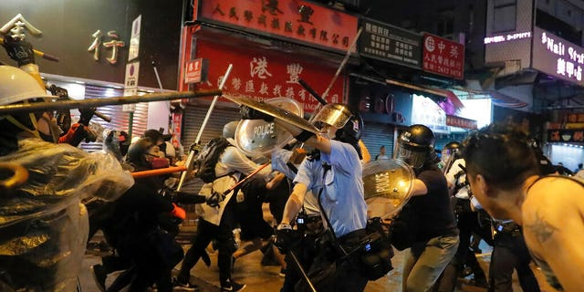 At least 21 police officers were injured Sunday during the pro-democracy protests, Mak Chin-ho, assistant police commissioner said.