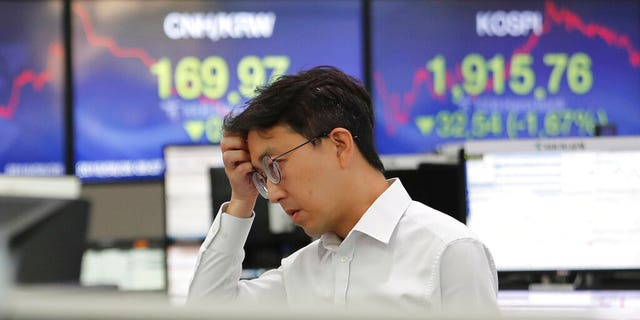 China announces it seeks 'calm' end to trade war, as markets tank and currency hits 11-year flatline AP19238053861722