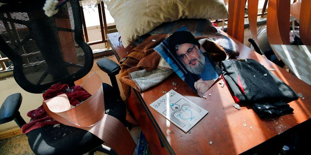 Aug. 25, 2019: Hezbollah leader Sayyed Hassan Nasrallah lies amid other damage inside the Lebanese Hezbollah media office, in a southern suburb of Beirut, Lebanon. The long shadow war between Israel and Iran has burst into the open in recent days, with Israel allegedly striking Iran-linked targets as far away as Iraq and crash-landing two drones in Lebanon. These incidents, along with an air raid in Syria that Israel says thwarted an imminent Iranian drone attack, have raised tensions at a particularly fraught time. (AP Photo/Bilal Hussein)