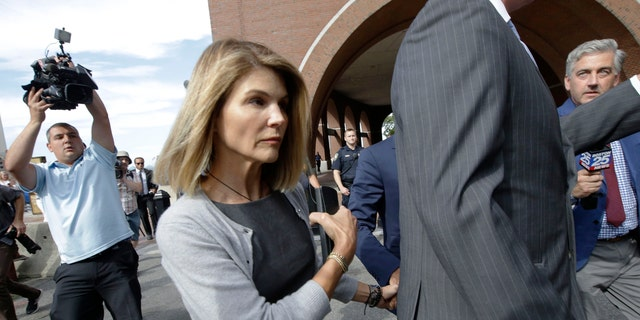 Lori Loughlin departs federal court Tuesday, Aug. 27, 2019, in Boston, after a hearing in a nationwide college admissions bribery scandal. (AP Photo/Steven Senne)