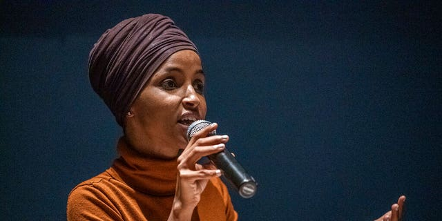 U.S. Rep. Ilhan Omar speaks at a town hall in South Minneapolis on ICE and the administration's immigration detention policies, at the Colin Powell Center in Minneapolis on Tuesday, Aug. 27, 2019. Omar, part of the liberal Squad in the House, detailed some positive elements of her relationship with House Speaker Nancy Pelosi, D-Calif., in a new biography of Pelosi by USA Today's Susan Page. (Richard Tsong-Taatarii/Star Tribune via AP)