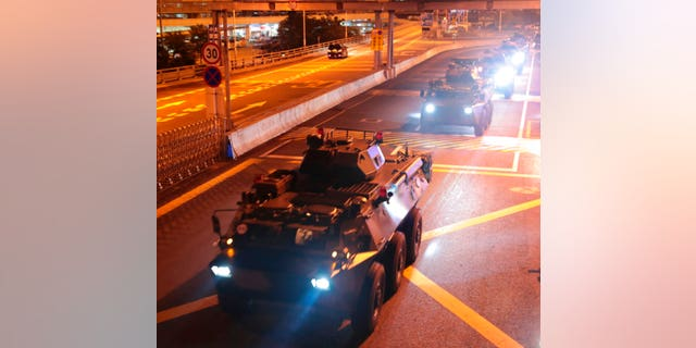 Armored personnel Vehicles of the Chinese People's Liberation Army (PLA) pass the Huanggang harbor border between China and Hong Kong, Thursday, August 29, 2019.