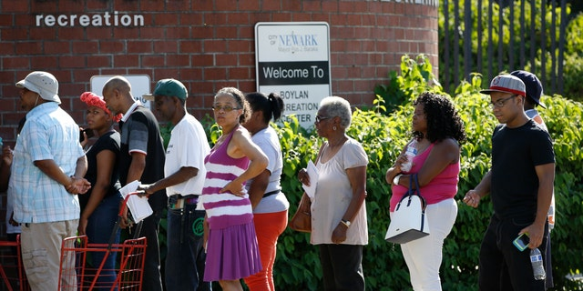City residents line up at the Boylan Street Recreation Center with cases of bottled water, Monday, Aug. 12, 2019, in Newark, N.J., after recent U.S. Environmental Protection Agency tests showed elevated levels of lead in the drinking water in some areas. (Associated Press)