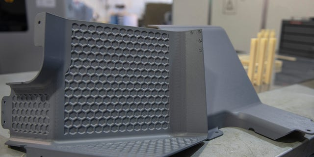 Latrine covers, the first aircraft parts authorized for use after being printed on the Stratasys F900 3D printer are on display Aug. 15, 2019, at Travis Air Force Base, California.