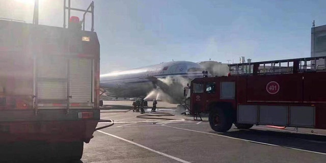 The plane was scheduled for a 5:10 p.m. departure, local time, when the smoke began pouring from both the front and back of the plane.