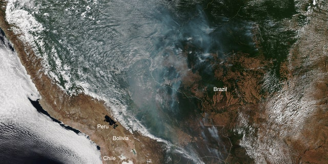 A recent satellite photo shows smoke from wildfires across the Amazon.