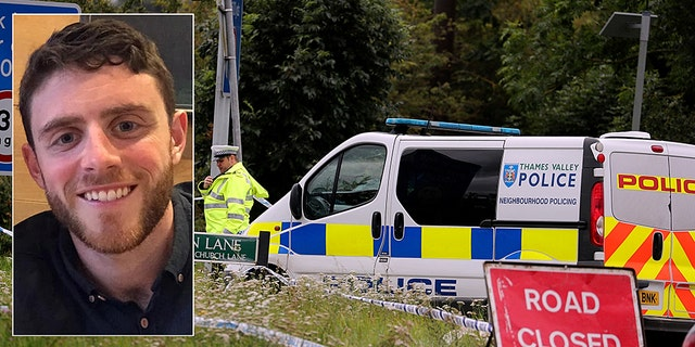 A police investigator at the scene of an incident where a police officer was killed, near Sulhamstead, England, Friday. (Steve Parsons/PA via AP)