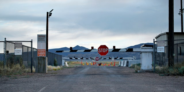 In this July 22, 2019 file photo, signs warn about trespassing at an entrance to the Nevada Test and Training Range near Area 51 outside of Rachel, Nev.