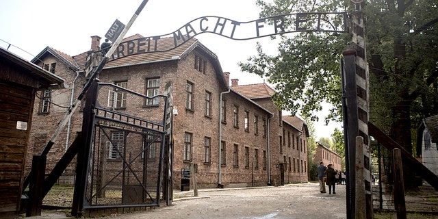 Arbeit macht frei (work sets you free) slogan on the entrance of Auschwitz concentration camp, the biggest extermination camp in Europe built by the Nazis during World War II. (iStock)