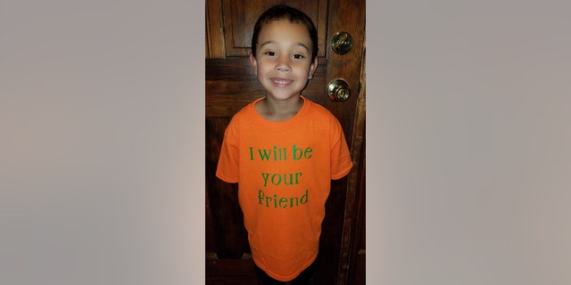 Six-year-old Blake Rajahn, pictured, wearing his internet-famous shirt.
