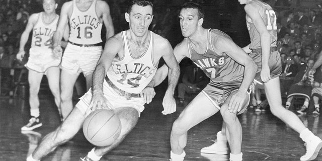 Bob Cousy (14) playing for the Celtics in 1954.