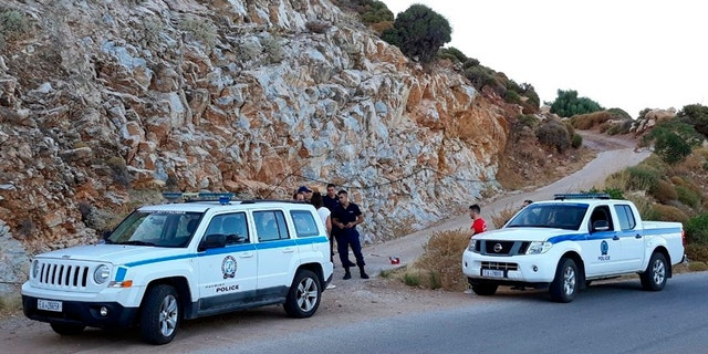 Authorities block a road near the location where police said the body of Cyprus-based astrophysicist Natalie Christopher, 34, was found in a ravine on Wednesday.