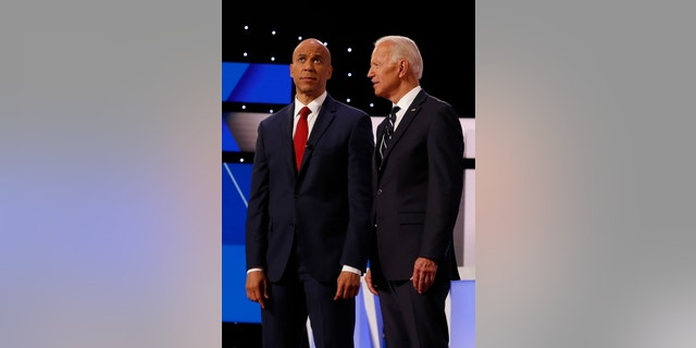 Sen. Cory Booker, D-N.J., and former Vice President Joe Biden are photographed at the second of two Democratic presidential primary debates at the Fox Theatre in Detroit.
