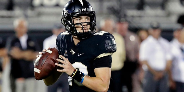 FILE - In this Sept. 21, 2018, file photo, Central Florida quarterback McKenzie Milton looks for a receiver during the first half of an NCAA college football game against Florida Atlantic in Orlando, Fla. Part of the sales pitch that lured Milton from his home state of Hawaii to UCF was a pledge by then-Knights coach Scott Frost to help put the quarterback on a path to a post-playing career in coaching. (AP Photo/John Raoux, File)