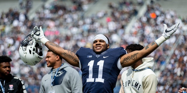 FILE - In this April 21, 2018, file photo, Penn State linebacker Micah Parsons acknowledges the crowd before the Blue-White spring college football game in State College, Pa. Last year, Parsons put together the greatest freshman season for a linebacker in Penn State's long history. He says he learned that earning a starting spot takes more than making a bunch of tackles. (Joe Hermitt/PennLive.com via AP)