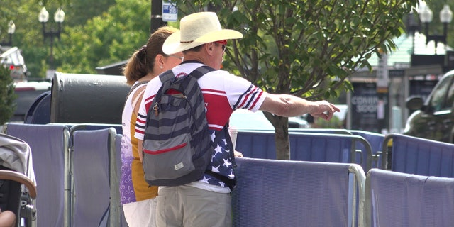 Carlos Arredondo and his wife Malida inspect the work underway on the memorial near the finish line.