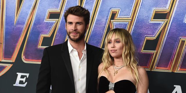 "Liam Hemsworth, left, and Miley Cyrus arrive at the premiere of ""Avengers: Endgame"" at the Los Angeles Convention Center."