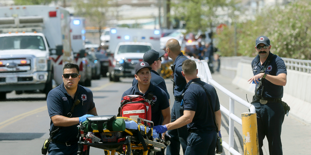 El Paso Fire Medical personnel arrive at the scene of a shooting at a Walmart near the Cielo Vista Mall in El Paso, Texas, on Aug. 3, 2019.  (Mark Lambie/The El Paso Times via AP, File)