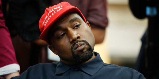 Rapper Kanye West listens to a question from a reporter during a meeting in the Oval Office of the White House with President Donald Trump in Washington.