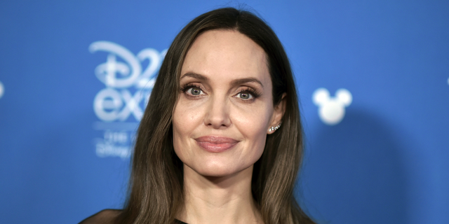 "Angelina Jolie attends the ""Go Behind the Scenes with the Walt Disney Studios,"" press line at the 2019 D23 Expo"