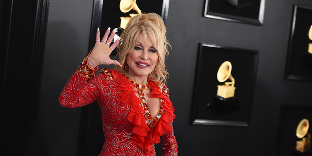 Parton also addressed whether she has her longtime husband Carl Dean's name tattooed on her body.