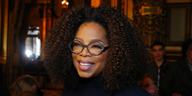 Oprah Winfrey at the presentation of Stella McCartney's ready-to-wear Fall-Winter 2019-2020 fashion collection in Paris on March 4, 2019 (AP Photo/Michel Euler, File)