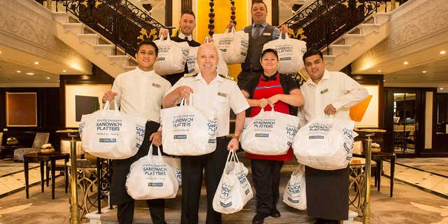 """Captain Johannes Tysse, center, said the crew from the U.K. convinced him the trip """"wouldn't be complete without a taste"""" of the local bakery chain."""