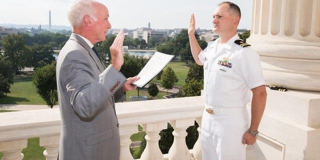 Rep. Joe Courtney and Lt. Jonathan Cebik at Cebik's promotion ceremony.