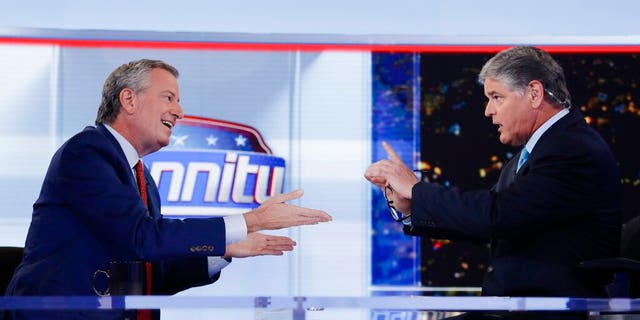 """Fox News host Sean Hannity, right, interviews Democratic presidential candidate and New York Mayor Bill de Blasio during a taping of his show, """"Hannity."""" (AP Photo/Frank Franklin II)"""