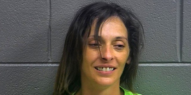 Donna Martin, 35, was charged with burglary and public intoxication after police say she broke into a bar before it opened on Monday.