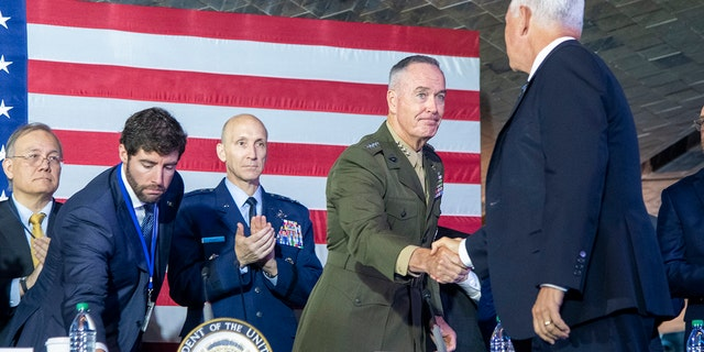 Marine Corps Gen. Joe Dunford, chairman of the Joint Chiefs of Staff, greets Vice President Mike Pence during the sixth meeting of the National Space Council. (DOD photo by U.S. Navy Petty Officer 1st Class Dominique A. Pineiro)