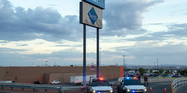 Texas state police cars block the access to the Walmart store in the aftermath of a mass shooting in El Paso, Texas, Saturday, Aug. 3, 2019.