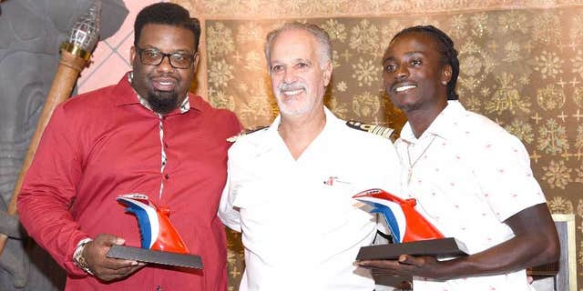 Kashief Hamilton (left) and Randolph Donovan (right) were honored for their heroic efforts in a ceremony on the Carnival Fascination in St. Thomas.