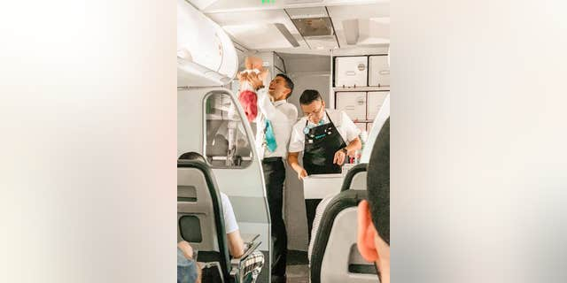 """This flight attendant on Frontier Airlines from Tyler to Denver helped a mom calm her screaming baby, and it was PRECIOUS!!"" wrote Facebook user Jamie Applegate Hunter."