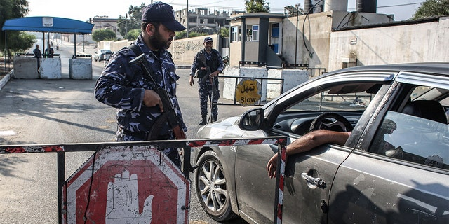 Security forces loyal to Hamas stopping a vehicle at a checkpoint in Khan Yunis in the southern Gaza Strip on Wednesday.