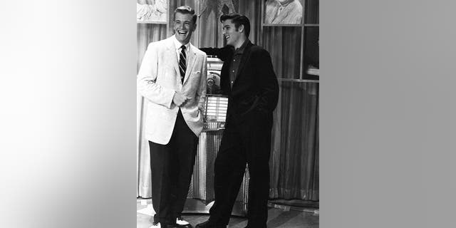 "American singer Elvis Presley with presenter Wink Martindale (left) on Wink's television show ""Teenage Dance Party"" in Memphis, Tenn., on June 16, 1956. (Photo by Silver Screen Collection/Getty Images)"